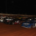 The Carolina Crown field goes four-wide for a parade lap prior to the start of Saturday's 60-lap feature at Lancaster (S.C.) Speedway. (Larrie Ervin Photo)