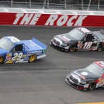 Ryan Blaney (29), Darrell Wallace Jr. (54) and Joey Coulter battle for position Sunday during NASCAR Camping World Truck Series action at Rockingham (N.C.) Speedway. (Adam Fenwick/AKFPhotos.com Photo)