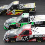 Darrell Wallace Jr. (54), Miguel Paludo (32) and Jeb Burton battle three-wide during Sunday's NASCAR Camping World Truck Series race at Rockingham (N.C.) Speedway. (Adam Fenwick/AKFPhotos.com Photo)