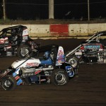 Jake Blackhurst (25), Colton Cottle (5c) and Justin Peck battle during Lucas Oil POWRi National Midget Series feature Friday at Jacksonville (Ill.) Speedway. (Mark Funderburk Photo)
