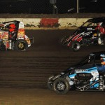 Shane Cockrum (14), Christopher Bell (71) and A.J. Felker during Friday's Lucas Oil POWRi National Midget Series event at Jacksonville (Ill.) Speedway. (Mark Funderburk Photo)