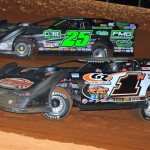 Shane Clanton (25) works his way by Dillon Wood to take the lead during Friday's World of Outlaws Late Model Series event at Smoky Mountain Speedway in Maryville, Tenn. (Michael Moats Photo)