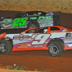 Shane Clanton (25) and Steve Casebolt battle during Friday's World of Outlaws Late Model Series race at Smoky Mountain Speedway in Maryville, Tenn. (Michael Moats Photo)