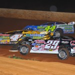 Clint Smith (44), Tommy Kerr (4T) and Darrell Lanigan go three-wide during Friday's World of Outlaws Late Model Series event at Smoky Mountain Speedway in Tennessee. (Michael Moats Photo)