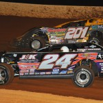 Billy Ogle Jr. (201) and Rick Eckert during Friday's World of Outlaws Late Model Series race at Smoky Mountain Speedway in Maryville, Tenn. (Michael Moats Photo)