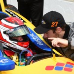 Rookie Carlos Munoz (left) gets some advice from teammate James Hinchcliffe Saturday at Indianapolis Motor Speedway. (IndyCar Photo)