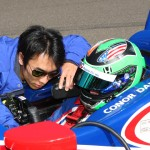A.J. Foyt Racing drivers Takuma Sato (left) and Conor Daly chat during Monday's Indianapolis 500 practice session at Indianapolis Motor Speedway. (IndyCar Photo)