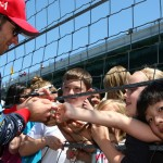 Marco Andretti signs autographs for young fans Tuesday at Indianapolis Motor Speedway. (IndyCar Photo)