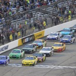 Matt Kenseth (20) and Brian Vickers (11) lead the NASCAR Sprint Cup Series field to the green flag during Saturday's Toyota Owners 400 at Richmond (Va.) Int'l Raceway. (HHP/Harold Hinson Photo)