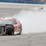 The damaged machine of David Reutimann rolls down victory lane during Sunday's NASCAR Sprint Cup Series race at Talladega (Ala.) Superspeedway. (HHP/Alan Marler Photo)