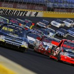 Ty Dillon (3) and Jeb Burton (4) lead the field at the start of Friday's NASCAR Camping World Truck Series race at Charlotte Motor Speedway. (HHP/Brian Lawdermilk Photo)