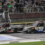 Kyle Busch (51) battles Miguel Paludo (32) for the race lead Friday during NASCAR Camping World Truck Series action at Charlotte Motor Speedway. (HHP/Harold Hinson Photo)