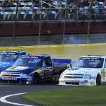 Tyler Young (02), Caleb Holman (75) and German Quiroga make contact during Friday's NASCAR Camping World Truck Series race at Charlotte Motor Speedway. (HHP/Rusty Jarrett Photo)