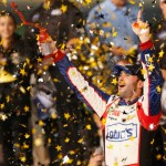Jimmie Johnson celebrates after winning Saturday's NASCAR Sprint All-Star Race at Charlotte Motor Speedway. (NASCAR Photo)