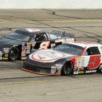 Travis Sauter (5) battles Jacob Goede during a battle for the race lead in Sunday's ARCA Midwest Tour event at Madison Int'l Speedway. (Doug Hornickel Photo)