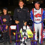 Kyle Grissom (center) was joined on the PASS South podium by Jay Fogleman (right) and Jared Irvan (left) Friday at Caraway Speedway. (Chris Owens Photo)