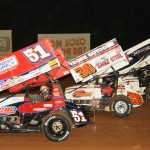 The stars of the World of Outlaws STP Sprint Car Series salute the fans by going four-wide at Williams Grove Speedway on Friday. (Julia Johnson Photo)