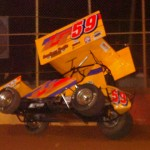 Jac Haudenschild slams into the wall Friday at Lincoln Speedway during World of Outlaws STP Sprint Car Series event. (Hein Brothers Photo)