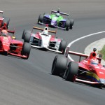 Carlos Munoz (26) leads the Firestone Indy Lights field through turn four during Friday's Firestone Freedom 100 at Indianapolis Motor Speedway. (Al Steinberg Photo)