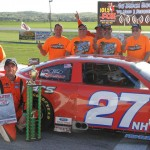 Wayne Helliwell Jr. stands in victory lane with his crew after winning Sunday's American-Canadian Tour feature at Devil's Bowl Speedway in Vermont. (Leif Tillotson Photo)