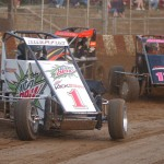 Scott Hatton (1) leads a pack of cars through turn one at Angell Park Speedway in Sun Prairie, Wis., on Sunday during Badger Midget Series action. (Roger Hamilton Photo)