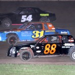 Ethan Ross (54), Mike Heimann (31) and Stuart White (88) race three wide during the street stock feature at Beaver Dam Raceway in Wisconsin. (Bob Cruse photo)