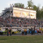 Fans visit with race drivers lined up on the frontstretch prior to Sunday's American-Canadian Tour race at Vermont's Devil's Bowl Speedway. (Leif Tillotson photo)