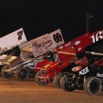 The stars of the Engine Pro Sprints on Dirt tour go four-wide to salute the fans Saturday at Plymouth (Ind.) Speedway. (Gary Gasper Photo)