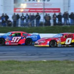 John Flemming (97) battles Shawn Turple for the race lead during Saturday's Parts For Trucks Pro Stock Tour event at Scotia Speedworld in Halifax, Nova Scotia. (Ken MacIsaac Photo)