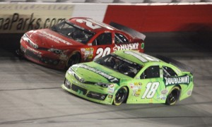 Matt Kenseth (20) battles Kyle Busch for the race lead during the NASCAR Sprint Cup Series Bojangles Southern 500 at Darlington (S.C.) Raceway in May. (Rich Iceland Photo)