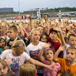 A crowd of kids enjoy the festivities during Family Fun Night Saturday at Ohio's Eldora Speedway. (Mike Campbell photo)