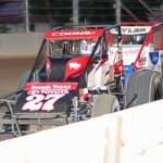 Jerry Coons Jr. (27) battles Brian Tyler during the Traxxas USAC Silver Crown Series event at the Indiana State Fairgrounds in May. (Gordon Gill Photo)