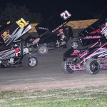 Beau Smith (51), Channin Tankersley (71) and Brandi Jass race through turn two during Friday's ASCS Gulf South Region event at Golden Triangle Raceway Park. (RonSkinnerPhotos.com Photo)