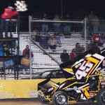 Johnny Herrera flashes under the checkered flag to win Friday's ASCS Gulf South Region feature at Golden Triangle Raceway Park. (RonSkinnerPhotos.com Photo)