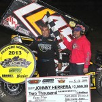 Johnny Herrera in victory lane Friday at Golden Triangle Raceway Park after winning the ASCS Gulf South Region feature. (RonSkinnerPhotos.com Photo)