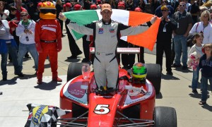 Peter Dempsey stands in victory lane after winning the Firestone Indy Lights Firestone Freedom 100 at Indianapolis Motor Speedway. (IndyCar Photo)