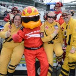 Firestone mascot Fire Hawk and the IndyCar safety crew at Indianapolis Motor Speedway on Sunday. (IndyCar Photo)