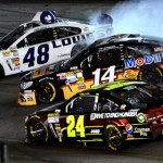 Jimmie Johnson (48) and Tony Stewart (14) get sideways as Jeff Gordon attempts to avoid them during Saturday's NASCAR Sprint Cup Series race at Richmond (Va.) Int'l Raceway. (NASCAR Photo)