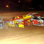 Tangling in the modified main at Lernerville Speedway are Rex King Jr. (165), Dave Murdick (61), Mike Turner (96) and Rex King Sr. (Hein Brothers photo)