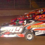 Battling it out three wide during the modified feature at Pennsylvania's Lernerville Speedway are Steve Feder (45), Frankie Guidace (1) and Dave Reges. (Hein Brothers photo)