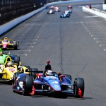 J.R. Hildebrand leads a pack of cars into turn one at Indianapolis Motor Speedway on Sunday. (IndyCar Photo)