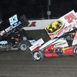 Sheldon Haudenschild (93) battles eventual winner Kerry Madsen during Friday's World of Outlaws STP Sprint Car Series feature at Eldora Speedway in Ohio. (Julia Johnson Photo)