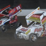 Brian Brown (21) and Paul McMahan battle for position during Friday's World of Outlaws STP Sprint Car Series event at Eldora Speedway. (Julia Johnson Photo)