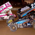 Eventual sprint car feature winner Brandon Spithaler (22) races under Scott Priester at Pennsylvania's Mercer Raceway Park. (Hein Brothers photo)