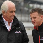 A.J. Allmendinger (right) chats with team owner Roger Penske Saturday at Indianapolis Motor Speedway. (Dave Heithaus Photo)