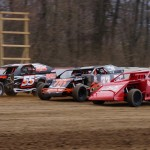 Modifieds battle three-wide at Indiana's Plymouth Speedway. (Gary Gasper photo)