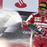 Fernando Alonso celebrates on the podium after winning the Spanish Grand Prix. (Steve Etherington Photo)