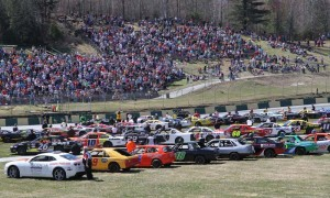 Cars and drivers line the infield prior to feature racing at Thunder Road Int'l Speedbowl in Barre, Vt., on Sunday. (Leif Tillotson Photo)