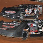 Chris Ferguson (21) and Dillon Wood (1w) race for the lead on the opening lap of Saturday night's Ultimate Super Late Model Series race at Smoky Mountain Speedway. (Michael Moats photo)