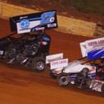 Chris Openshaw (17c) holds off Bobby Zaiontz (1) during USCS 600 micro sprint action at 411 Motor Speedway in Tennessee. (Chris Seelman photo)